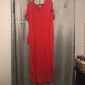 Coral maxi dress with the bottom sides split.